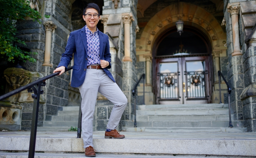 Minh on the steps of Healy Hall at Georgetown University